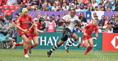"""Fiji Airways Fiji 7s forward Isake """"Eyes"""" Katonibau runs for the tryline during the pool game of the HSBC World Rugby Sevens Series in Hong Kong. Picture: RAMA"""