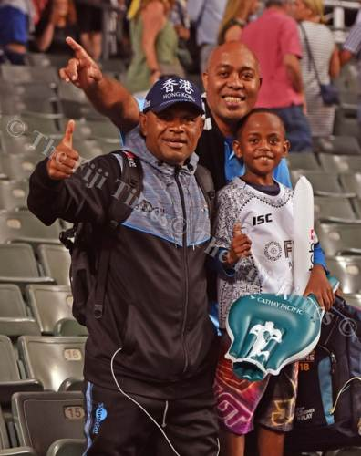 Ilaitia Tuisese Jr (left) with other Fiji fans during the first day of the HSBC World Rugby Sevens Series in Hong Kong. Picture: RAMA