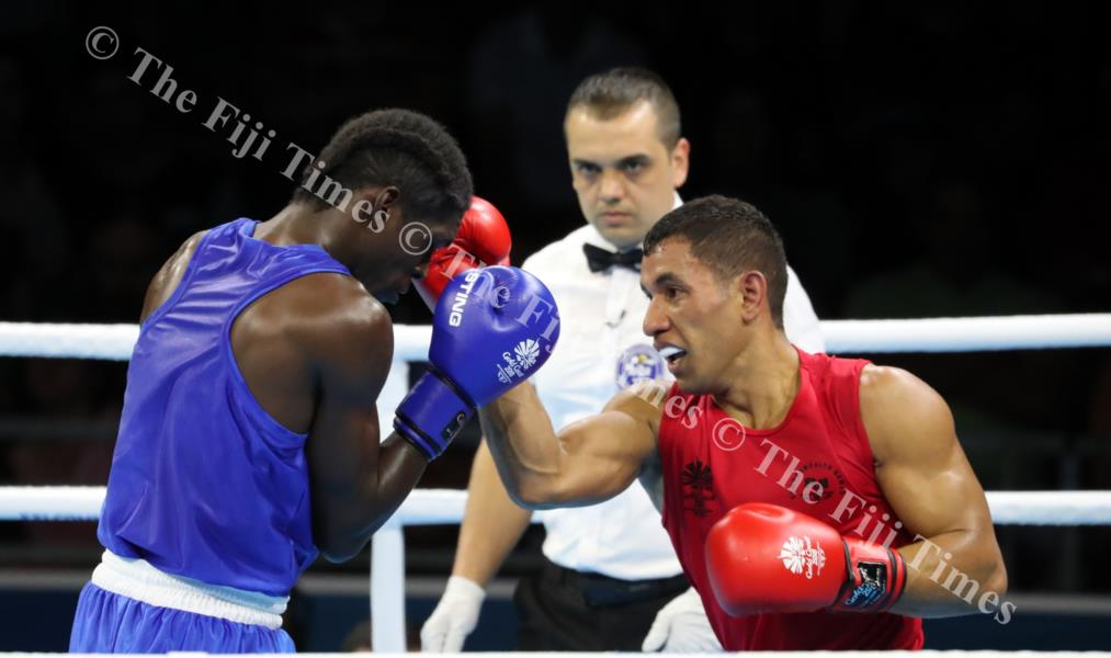 Fiji's Winston Hill pounds Lyndel Marcellin of St Lucia in the 69kg category to win the bout at the Commonwealth Games at Gold Coast in Australia. Picture ELIKI NUKUTABU