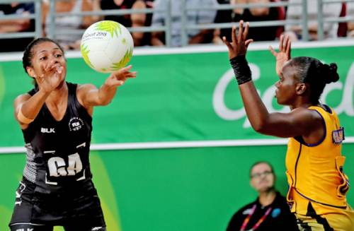 Maliana Rusivakula tussles with her Barbados counterpart during the Commonwealth Games netball competition. Picture: ELIKI NUKUTABU