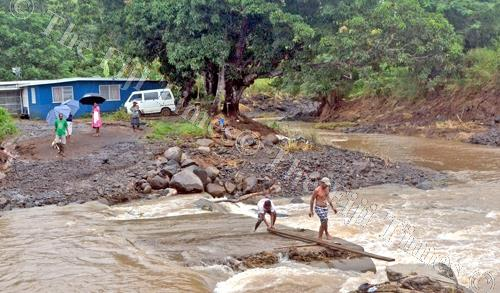 Residents try to make a temporary crossing at a bridge near Kalacraft in Lautoka. Picture: ALVEEN KUMAR