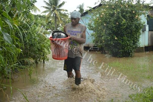 Ponijese Ravoka evacuates from his home in Taiperia settlement in Lautoka. Picture: REINAL CHAND