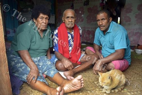 Setuate Temo (right) with his parents Jope Sova and Milika Vuna at their home in Taiperia settlement in Lautoka. Picture: REINAL CHAND
