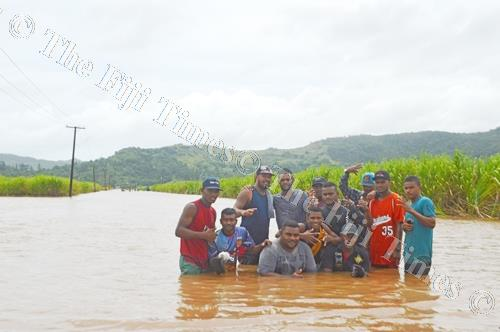 Youths and children of Qawa in Labasa frolic in floodwaters on Thursday last week. Picture: LUKE RAWALAI
