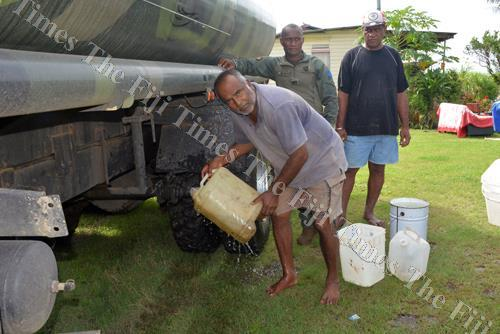 Suruj Pal fills water from a truck at his home in Mataniqara, Ba. Picture: REINAL CHAND