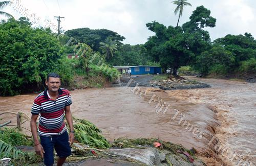 The author says our people have been to always care for one another in times of adversity. Ravindra Lal waiting for the water to recede at Galiwalu settlement in Lautoka. Picture: BALJEET SINGH