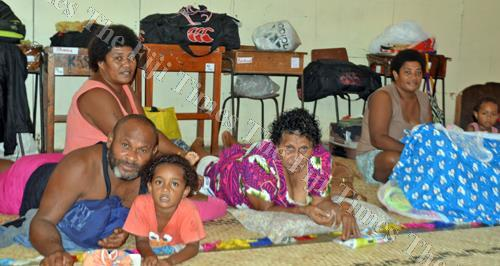 Residents of Vulovi settlement in Labasa take shelter at the Guru Nanak Khalsa College in Labasa yesterday. Picture: LUISA QIOLEVU