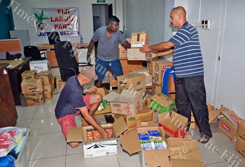Fiji Labour Party parliamentary leader Aman Ravindra-Singh (right) with Cedric Steven and Mac Eyre prepare rations for distribution at their office in Lautoka. Picture: BALJEET SINGH