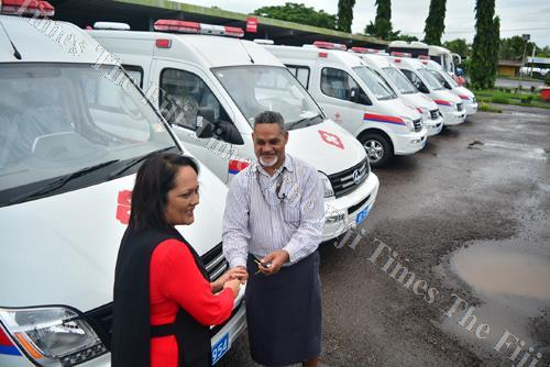 Minister for Health Rosy Akbar hands over one of the ambulance keys to Saimone Tawake who is a representative of the Central/Eastern division during the official handover on Monday. Picture: JOVESA NAISUA