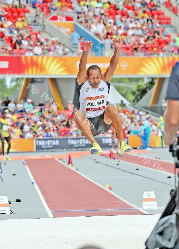 Fiji's Eugene Vollmer in full flight in the men's triple jump event at Carrara Stadium. Picture: ELIKI NUKUTABU