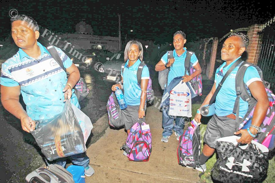 Members of the Fijiana team loading their travel gear on Thursday last week. Picture: ELIKI NUKUTABU