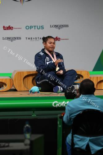 Eileen Cikamatana performs the traditional 'cobo' as a mark of respect after receiving her gold medal. Picture: ELIKI NUKUTABU