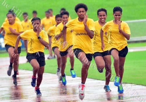 Adi Cakobau School athletes during a training session at the ANZ Stadium yesterday. Picture: JONA KONATACI