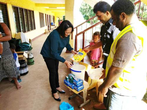 Fiji's Minister for Health and Medical Services Rosy Akbar while distributing the Wash and Hygiene kits to families at evacuation centres in the West. Picture: SUPPLIED