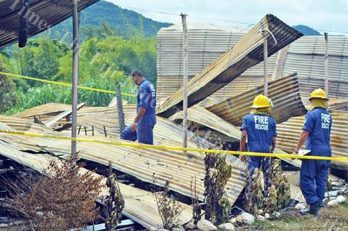 National Fire Authority and police personnel investigate the Naduna Technical College fire outside Labasa yesterday. Picture: LUKE RAWALAI