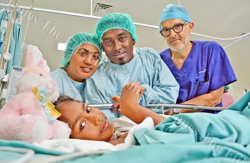 Reason to smile ... Ashley Chand, 9, with her parents, Devika, left, and William Chand and Dr David Linscott of New Zealand after her surgery at the CWM Hospital in Suva yesterday. Picture: JONACANI LALAKOBAU