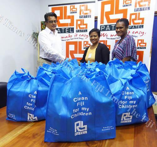 RB Patel general manager operations Jignesh Chauhan with Meena Sharma and a colleague at the handover. Picture: SUPPLIED