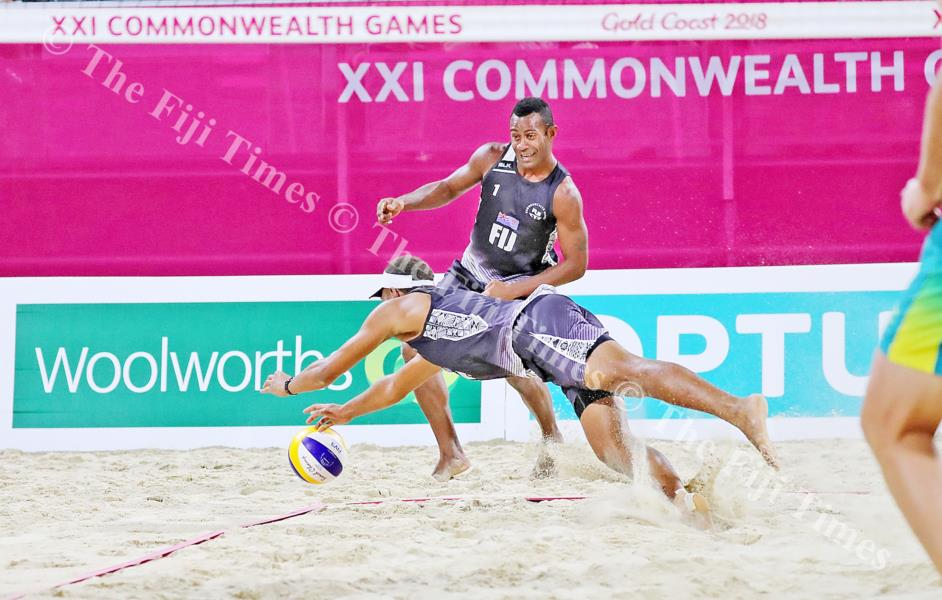 Another one bites the dust...Sairusi Cavula fails to get this volley while Inia Korowale looks on during the Commonwealth Games beach volleyball competition. Picture: ELIKI NUKUTABU