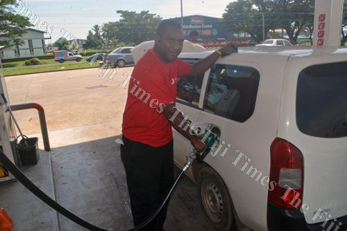 Semi Sailosi fills fuel in a car at Phil's Autoport in Lautoka. Motorists will fill the pinch in fuel prices from tomorrow after a recent price review. Picture: REINAL CHAND