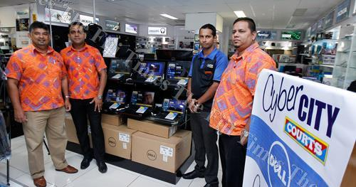Courts director of marketing Anil Seweniratne (left) with his team after the announcement of their official accreditation as a Dell agency at their Cyber City outlet in Damodar City, Suva yesterday. Picture ATU RASEA