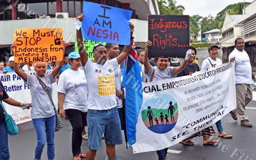 Workers with their placards during the human rights march in Suva. Picture: FILE