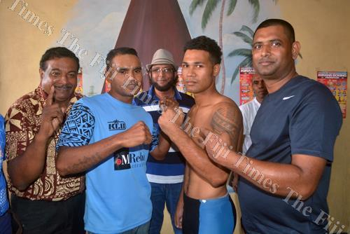 Kiran Boxing Promotion's Krishna Mudliar (right) with boxers Franco Fraser (3rd from right) and Krishna Mudaliar (2nd from left) during the weigh-in in Lautoka. Picture: REINAL CHAND