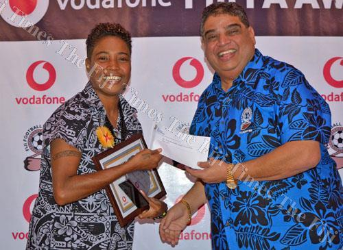 Coach of the Year, Laisani Mataele, receives her award from Fiji Football Association president Rajesh Patel during the Fiji Football Awards night at the Yue Lei Hotel in Suva last night. Picture: JONACANI LALAKOBAU