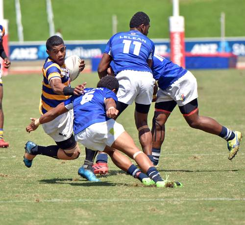 Peni Nanuku (left) of RKS attacks against Lelean during the secondary school U19 rugby league finals at the ANZ Stadium in Suva today. Picture: RAMA