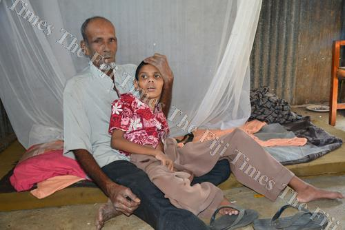 Mohammed Yunus with his son Mohammed Fazil at their home in Vunato, Lautoka. Picture: REINAL CHAND