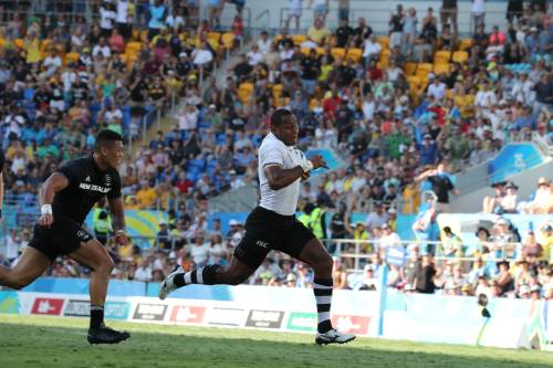 Fiji's Paula Dranisinukula dashes to the try line only to be stopped short against NZ in the 2018 Commonwealth Games men's rugby final. Picture: ELIKI NUKUTABU