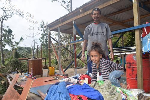 Rupeni Cama and his six-year-old daughter Iliana Balesakau look at what is left of their personal belongings. Picture SIKELI QUNADOVU