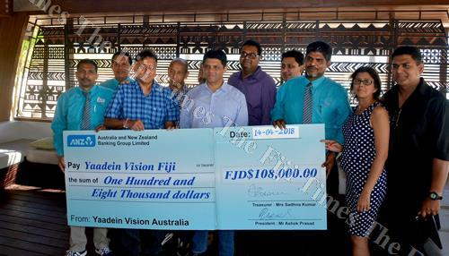 Attorney-General Aiyaz Sayed-Khaiyum with Yaadein Vision Group members during the cheque presentation at the Fiji Marriott Resort Momi Bay in Nadi. Picture: BALJEET SINGH