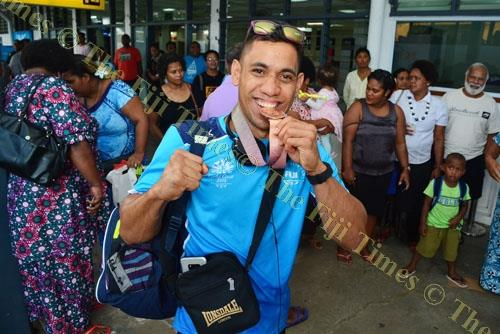 Commonwealth Games boxing medallist Winston Hill at the Nausori International Airport with the Fiji team yesterday. Picture: JOVESA NAISUA