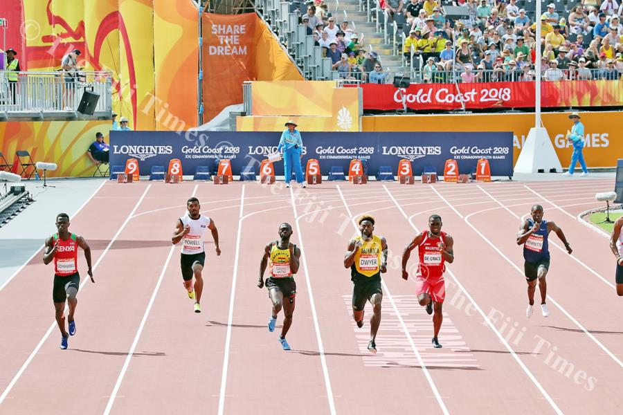 Aaron Powell (second from left) runs in the 200 metres heats at the Carrara Stadium. Picture: ELIKI NUKUTABU