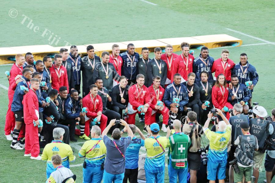 The three medal winners, Fiji, New Zealand and England pose for a group photo after the final. Picture: ELIKI NUKUTABU