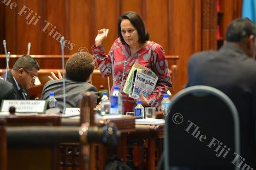 Minister for Health and Medical Services Rosy Akbar in a discussion with Minister for Women, Children and Poverty Alleviation Mereseini Vuniwaqa inside the Parliament complex yesterday. Picture: JOVESA NAISUA